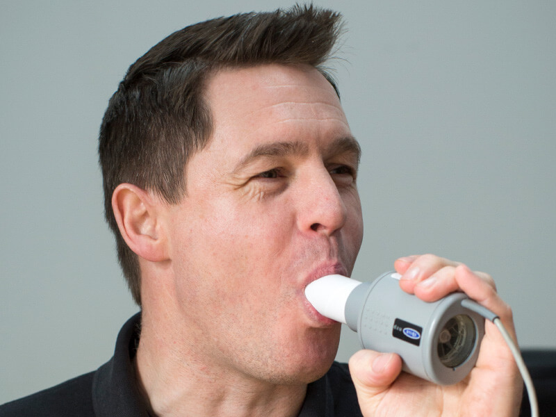 A man taking a lung function test.